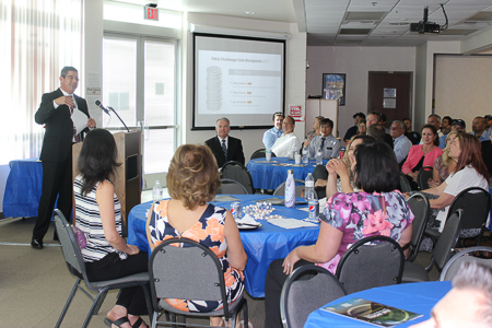 Earlier Director, Tabin Cosio, giving a talk to PWA Employees.